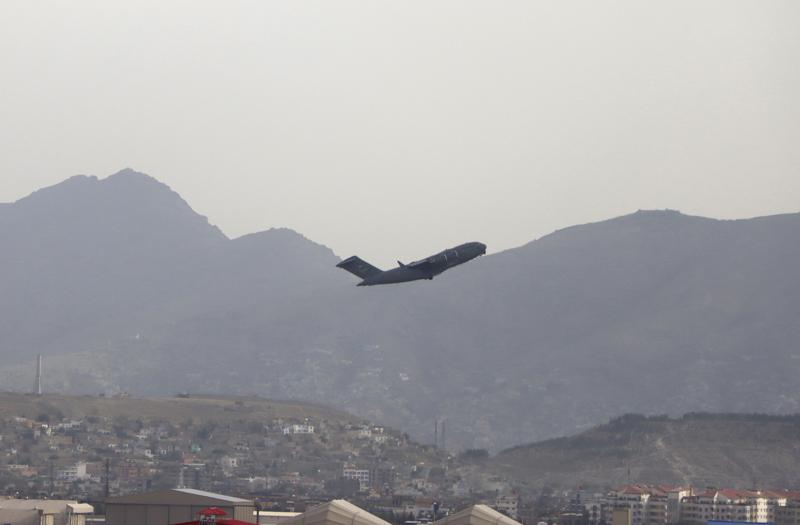 A U.S military aircraft takes off from the Hamid Karzai International Airport in Kabul, Afghanistan, Monday, Aug. 30, 2021. (AP Photo/Wali Sabawoon)